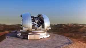 Artist's impression of the European Extremely Large Telescope (E-ELT) in its enclosure on Cerro Armazones, a 3060-metre mountaintop in Chile's Atacama Desert. The 39-metre E-ELT will be the largest optical/infrared telescope in the world — the world's biggest eye on the sky. Operations are planned to start early in the next decade, and the E-ELT will tackle some of the biggest scientific challenges of our time. The design for the E-ELT shown here is preliminary.