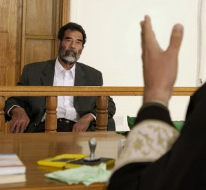 Former and deposed President of Iraq, Saddam Hussein, sits before an Iraqi judge at a courthouse in Baghdad, Iraq, where he has his initial interview to inform him of what he is being investigated for and his legal rights read to him. Date1 July 2004 Former and deposed President of Iraq, Saddam Hussein, sits before an Iraqi judge at a courthouse in Baghdad, Iraq, where he has his initial interview to inform him of what he is being investigated for and his legal rights read to him. Keywords: Releasing Authority Kristi Klem